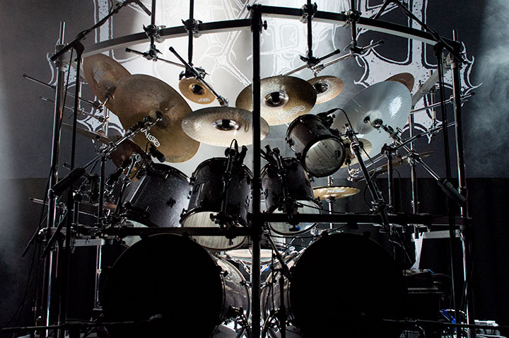 Illustration photo of drumkit with stage lights and a Mayhem backdrop